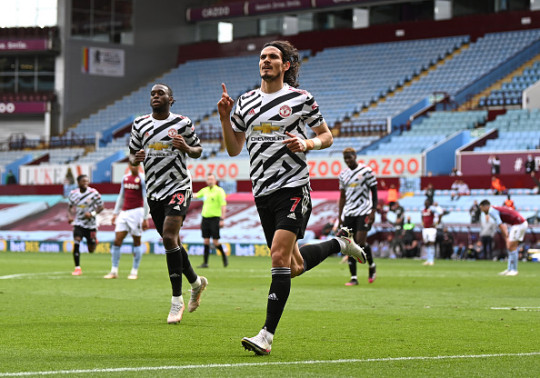 Edinson Cavani of Manchester United celebrates after scoring their side's third goal during the Premier League match between Aston Villa and Manchester United at Villa Park on May 09, 2021 in Birmingham, England. Sporting stadiums around the UK remain under strict restrictions due to the Coronavirus Pandemic as Government social distancing laws prohibit fans inside venues resulting in games being played behind closed doors.