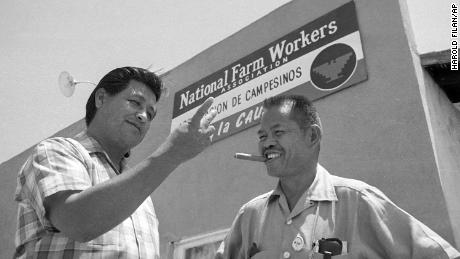 Larry Itliong, right, a Filipino-American labor leader and organizer with United Farm Workers leader Cesar Chavez, left,  in front of union headquarters.
