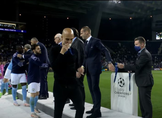 Pep Guardiola kissed his runners-up medal after Man City's defeat in the Champions League final