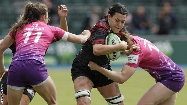 Emma Taylor is tackled by two Loughborough players