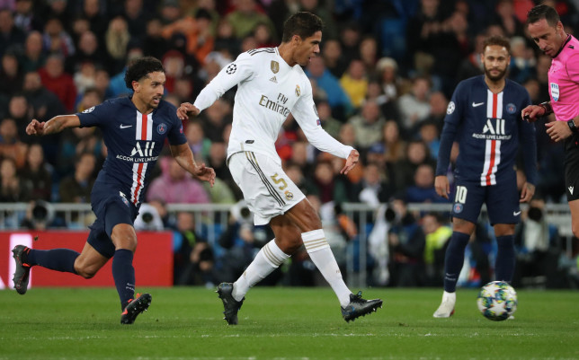 Marquinhos and Raphael Varane do battle in PSG's Champions League clash with Real Madrid