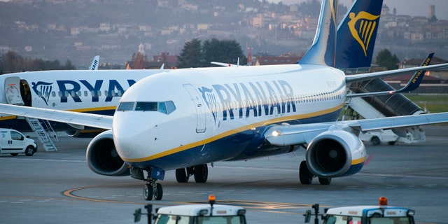 """Bergamo, Italy - March 18, 2016: Ryanair B737 taxiing to depart at Bergamo-Orio al Serio International Airport. A Ryanair flight from Dublin, Ireland to Krakow, Poland Sunday was diverted to Berlin, Germany due to a """"potential security threat on board."""" Ryanair is the largest low-cost European airline by scheduled passengers carried."""