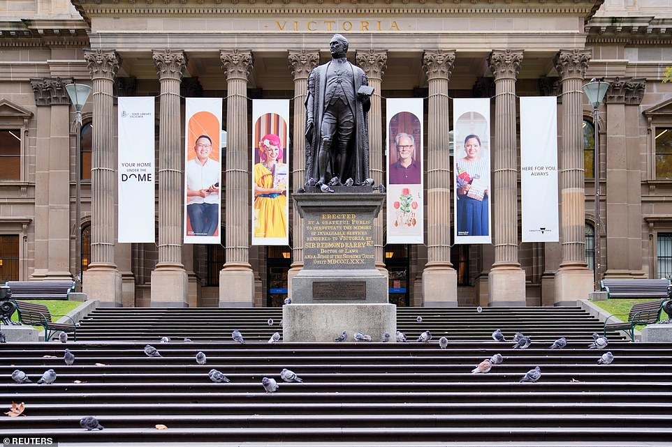 The Australian state of Victoria has imposed brutal 'stay at home' lockdown rules after detecting just 30 cases of the Indian variant, while the UK is lifting restrictions with more than 3,500 Covid cases per day (pictured: pigeons sit on empty State Library of Victoria steps on the first day of a seven-day 'circuit breaker')