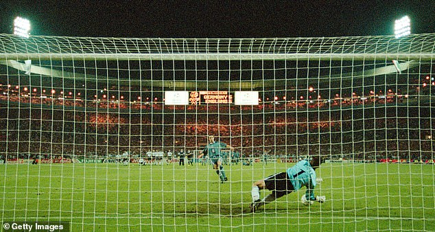 A scientific study has found the reason some football players 'choke' when taking a penalty kick. Pictured,the notorious 1996 effort by the now-England manager Gareth Southgate, which led to defeat at the hands of the clinical Germans in the Euro '96 final
