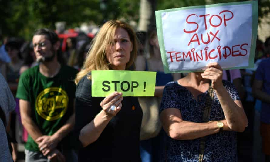 Women display signs during a demonstration against violence against women in Paris
