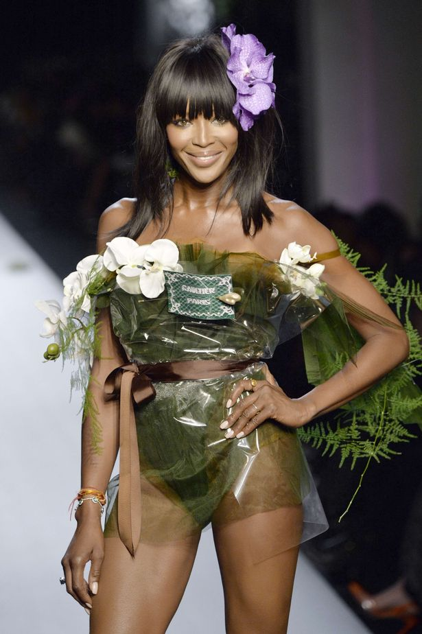 Model Naomi Campbell presents a creation by Jean Paul Gaultier during the 2015 Haute Couture Spring-Summer collection fashion show on January 28, 2015 in Paris.
