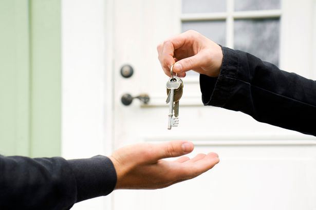Person exchanging keys with another.