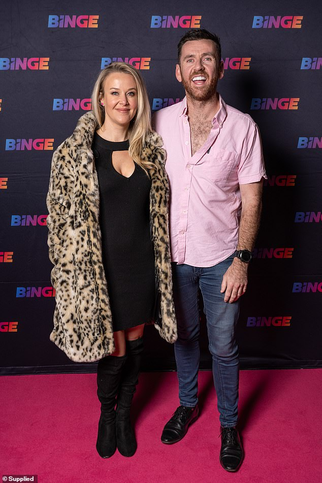 Keeping it casual: Peter Deppler also stepped out for the event and posed alongside the dating columnist for a photo.The Kyle and Jackie O radio producer, best known as Intern Pete, did not seem affected by the evening autumn chill dressed in just a pink button up shirt with jeans