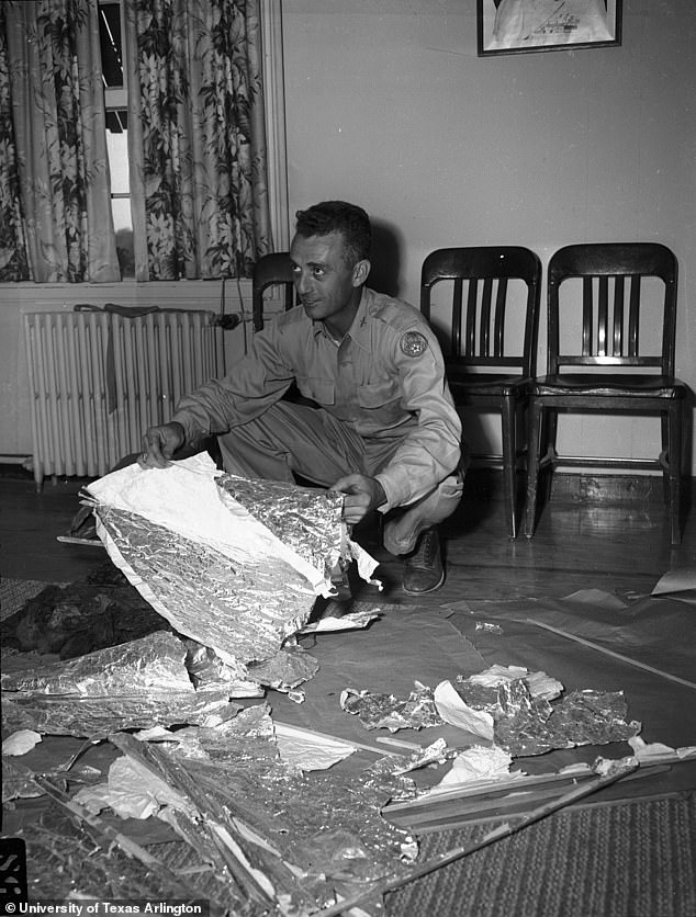 The Air Force report regarding the event states the debris were pieces from Project Mogal's balloons, sensors and radar reflectors made of thin metal. Pictured is Marcel with the debris