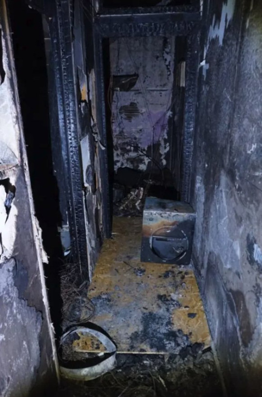 House for sale in Halifax - fire damaged hallway