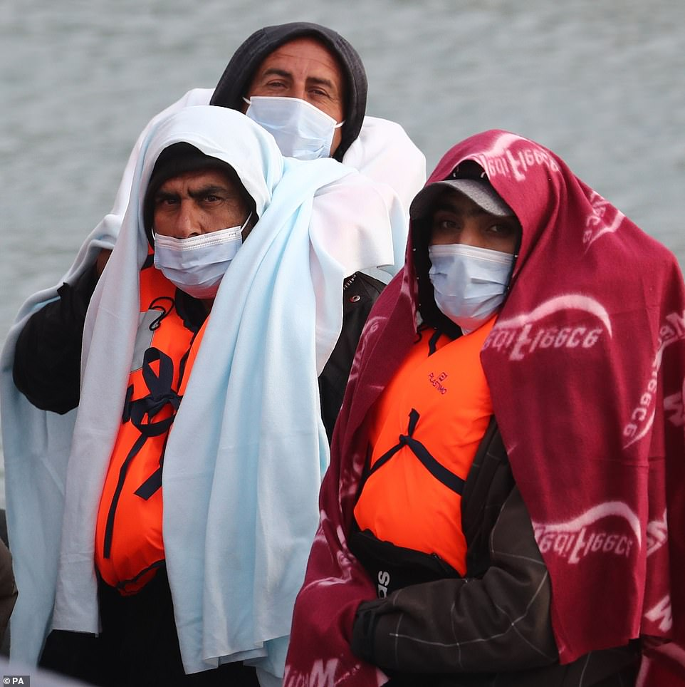 Migrants are pictured this morning as they are brought into Dover following a small boat incident in the Channel