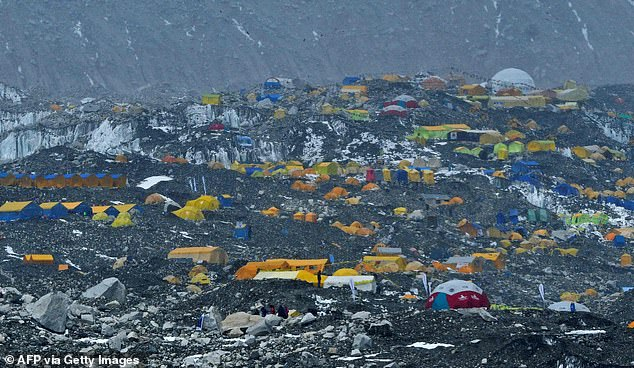 Pictured above is the Mount Everest base camp, Nepal, in April this year. There has been an outbreak at the camp and guides say at least 100 people have tested positive