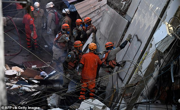 Firefighters and rescue teams continue to search for people trapped under the rubble after a building collapsed in Rio das Pedras on Thursday morning