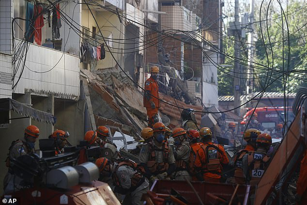 Firefighters search for more survivors after pulling some from the debris of a four-floor building that collapsed overnight in Rio das Pedras