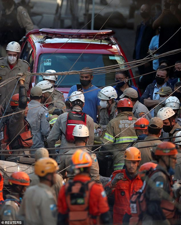Firefighters pulled a woman alive from the debris of the collapsed building on Thursday morning