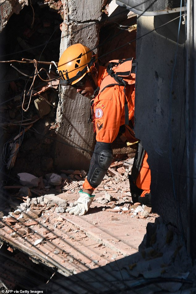Firefighters and rescue workers carefully surveyed the damage, looking for victims of an early morning building collapse in Rio das Pedras, Brazil