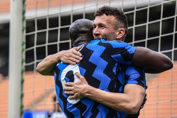 Ivan Perisic celebrates with Inter Milan's Romelu Lukaku after scoring against Udinese