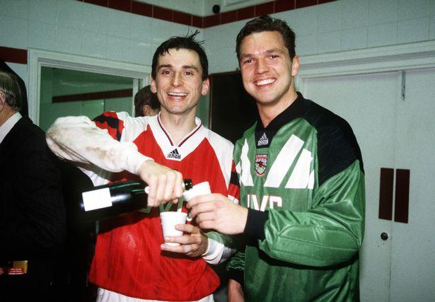 Millar (R) celebrates with teammate Alan Smith following Arsenal's semi-final win over PSG in '94