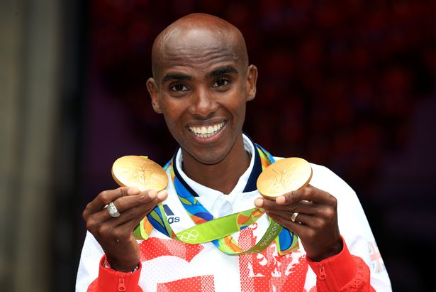 Farah shows off his 5,000m and 10,000m gold medals at Rio 2016