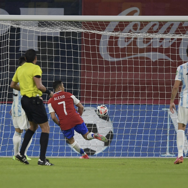 Alexis Sanchez of Chile scores the first goal of his team