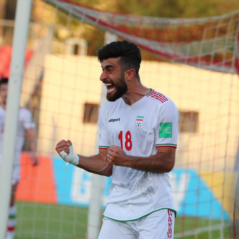 Ali Gholizadeh of IR Iran celebrates scoring against Hong Kong