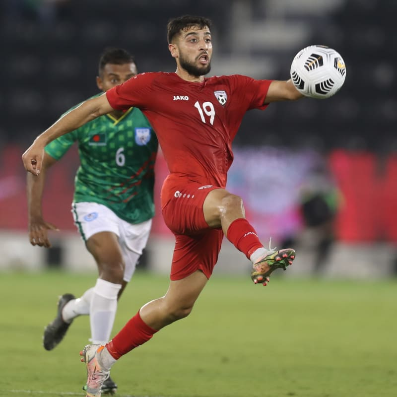 Omid Popalzay of Afghanistan controls the ball