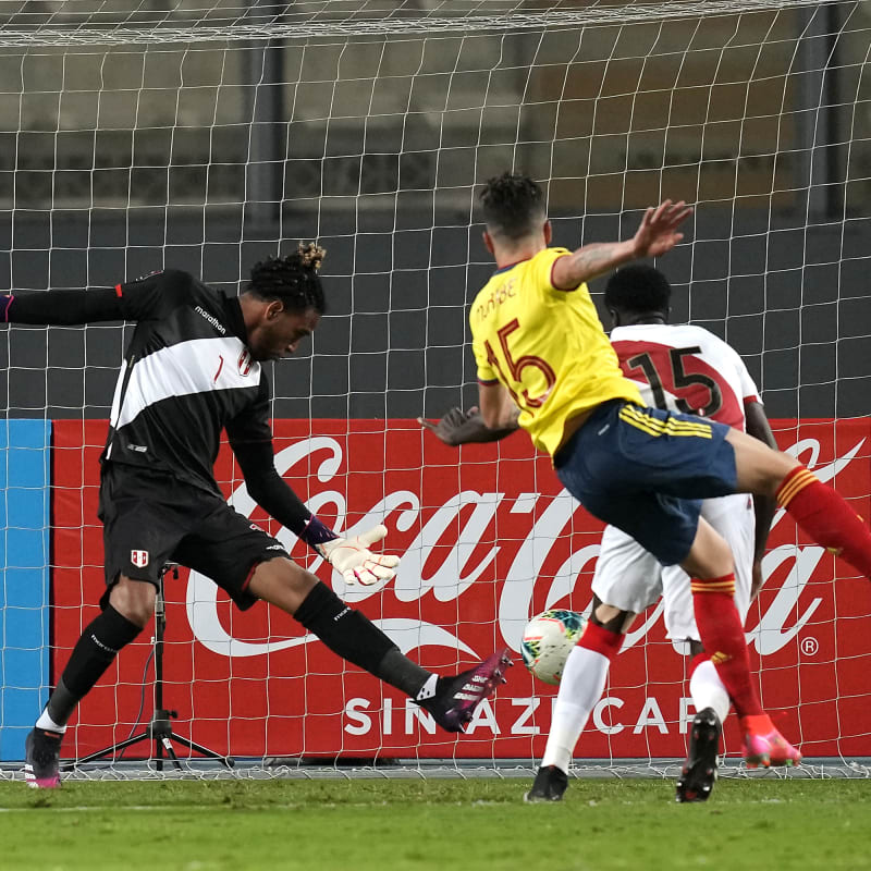 Mateus Uribe of Colombia kicks the ball to score the second goal