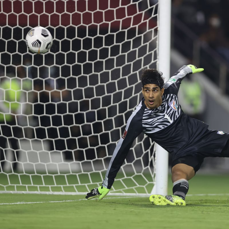 India goalkeeper Gurpreet Singh Sandhu watches on as Abdulaziz Hatem scores the winning goal for Qatar