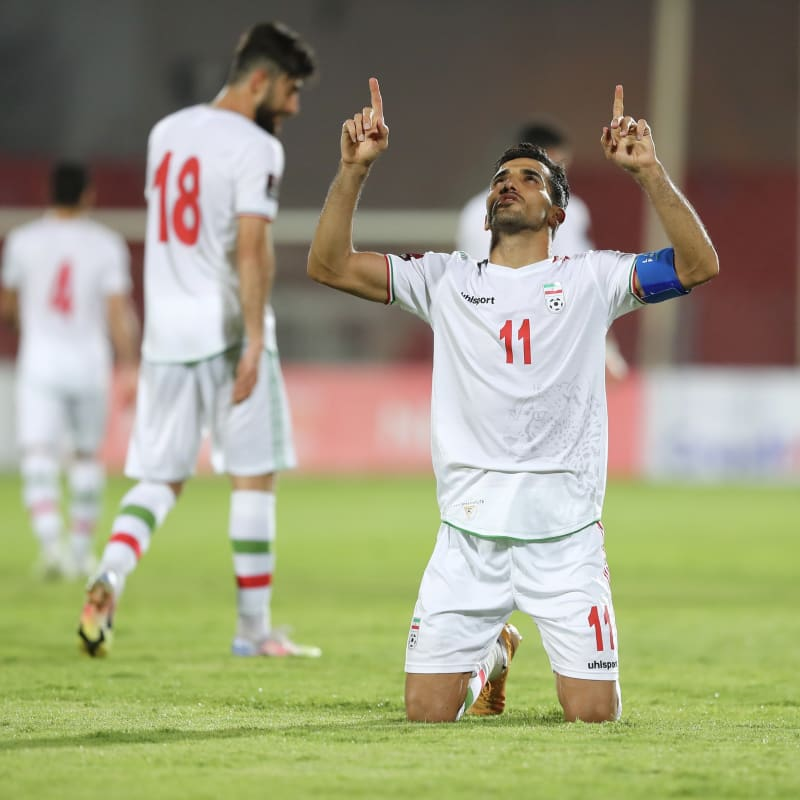 Vahid Amiri celebrates scoring for IR Iran against Hong Kong
