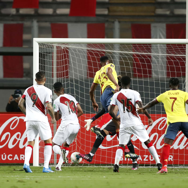 Yerry Mina of Colombia heads the ball to score the first goal