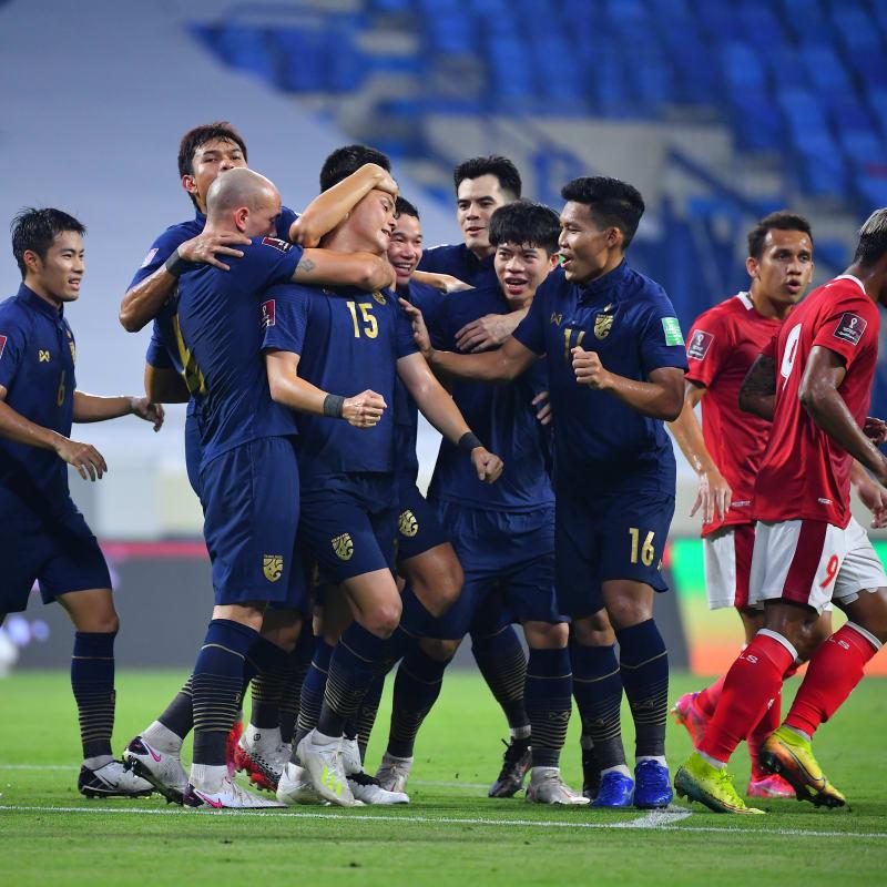 Thailand celebrate Narubodin Weerawatnodom's goal in a 2-2 draw with Indonesia