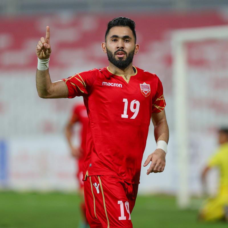Bahrain's Kamil Al Aswad celebrates during their 8-0 victory over Cambodia