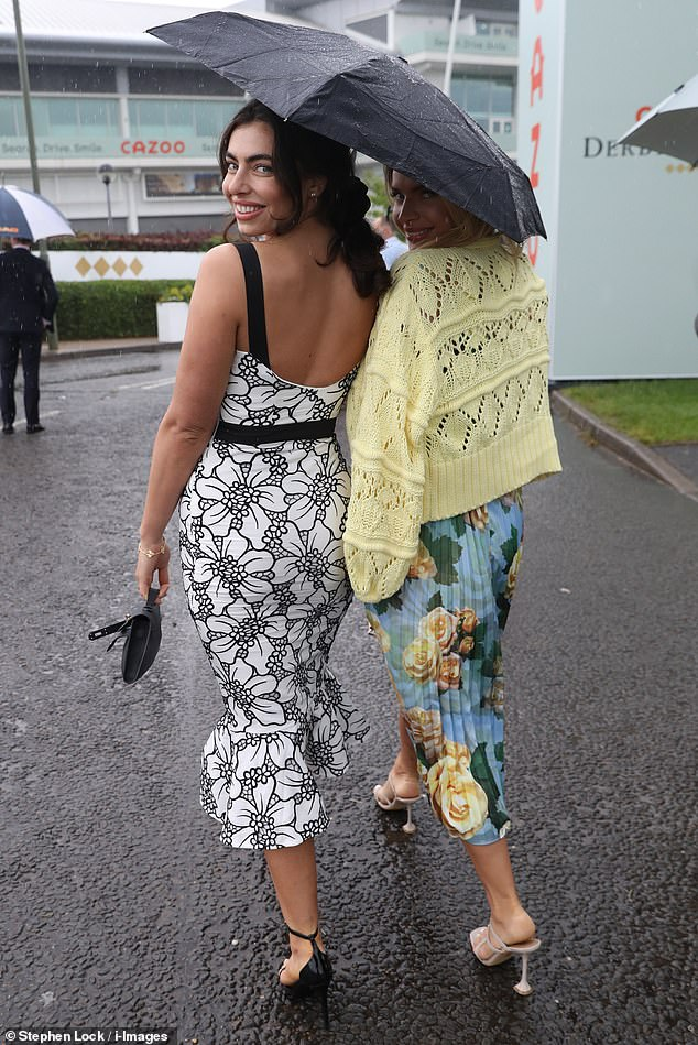 Wow:The TV star, 25, didn't let the dreary weather dampen her mood as she protected her monochromatic dress with an umbrella at the affluent venue, alongside her pal Maria Wild