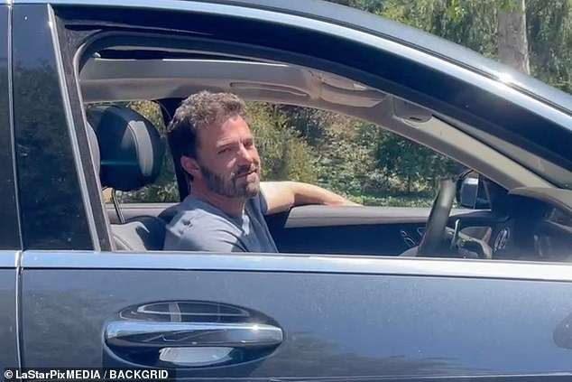Something to smile about: The 48-year-old actor is seen looking tired but happy while leaving Lopez's house in LA on Wednesday