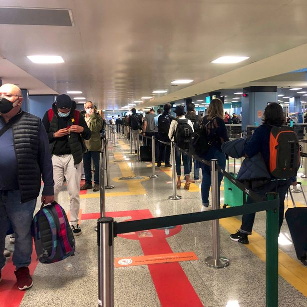 5am in Lisbon and the queues were getting longer at the airport. The first flight to London was full on the day after Britain announced it would remove the southern European destination from its green list