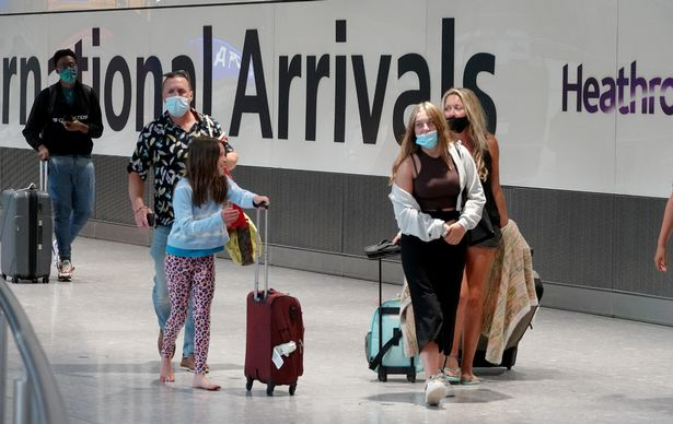 Passengers arriving back from Portugal at Heathrow today