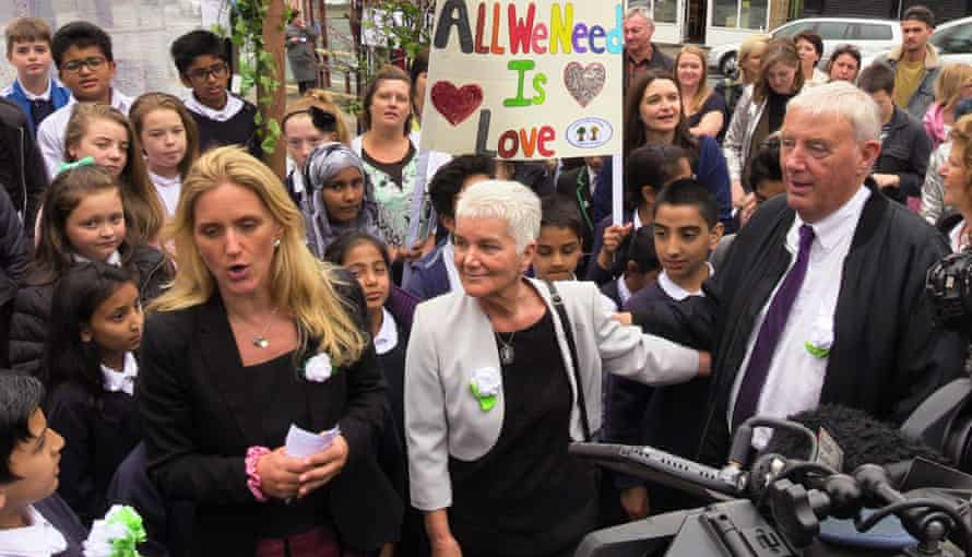 Jo Cox's sister Kim Leadbeater and parents Gordon and Jean Leadbetter address a small crowd in the marketplace in Birstall, West Yorkshire, on the first anniversary of the MP's murder.