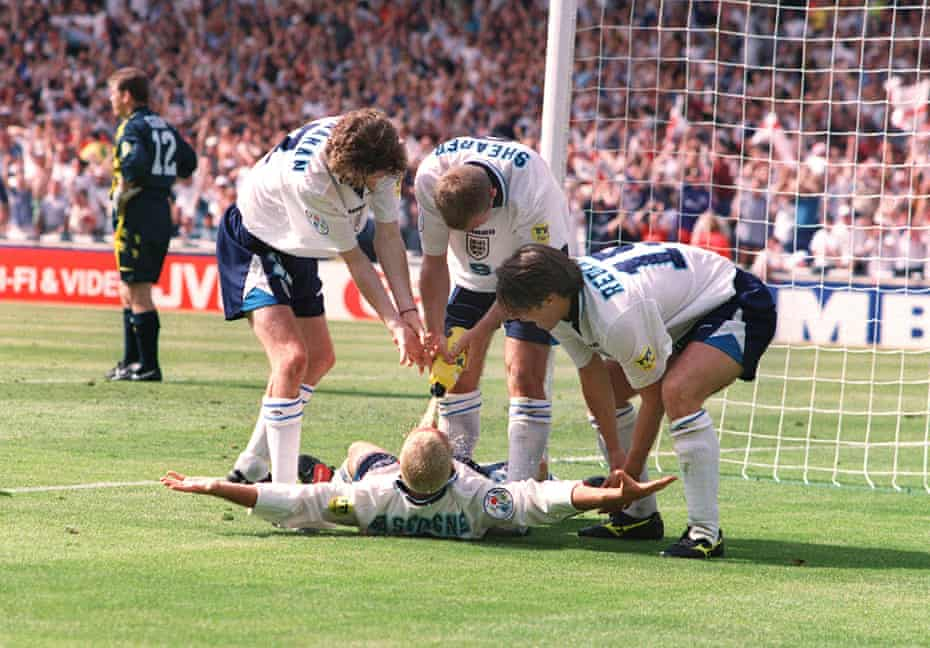 Paul Gascoigne and teammates celebrate scoring against Scotland, mimicking his notorious 'dentist's chair' drinking session.