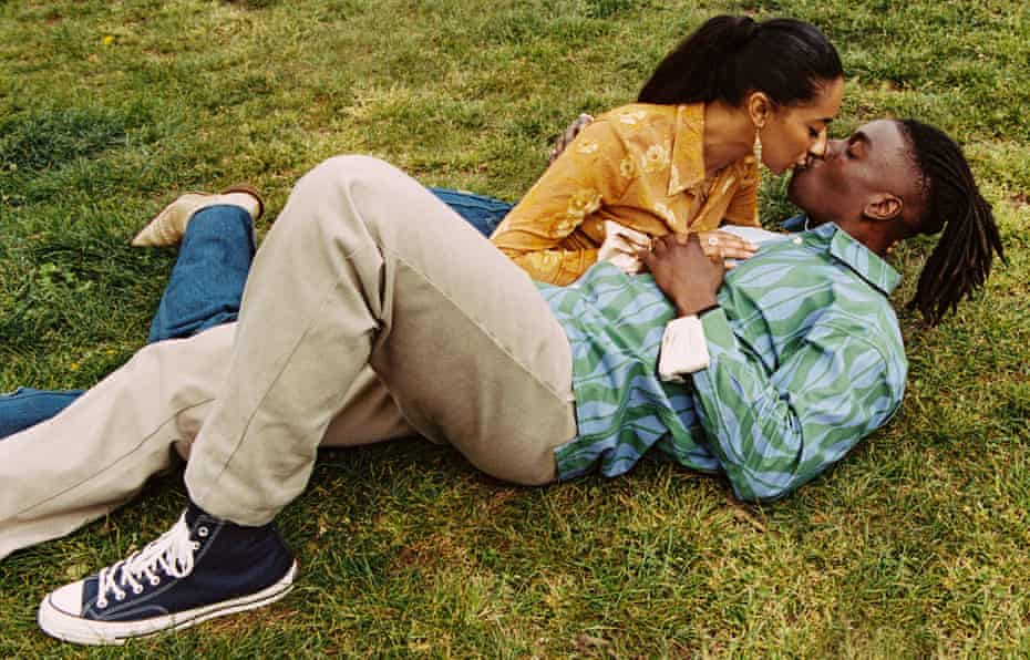 Sean Cole (28) and Sophia Alonge (27) lying on the grass and kissing, May 2021