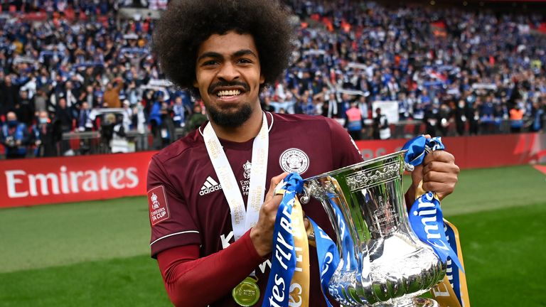 Hamza Choudhury of Leicester City celebrates with the Emirates FA Cup trophy following The Emirates FA Cup Final match between Chelsea and Leicester City at Wembley Stadium on May 15, 2021 in London, England.