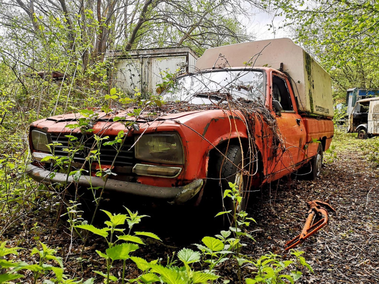 A vintage truck has been left to rust.