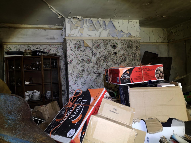 Boxes of junk have been left to pile up in the hoarder's home