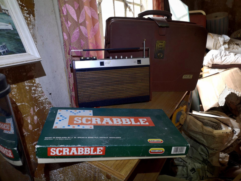 A vintage radio and game of Scrabble were left in the derelict property