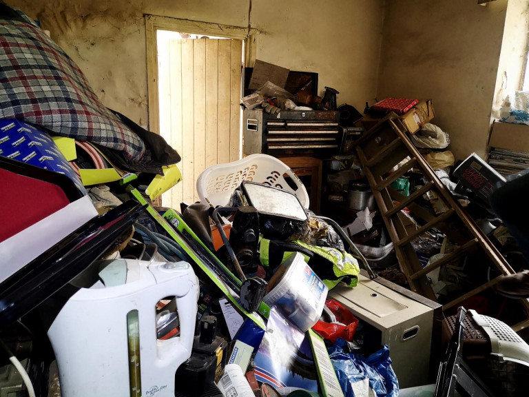 The living room was piled high with appliances and jun