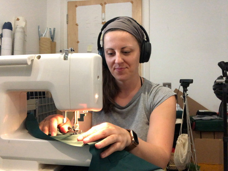 Libby Brewster using a sewing machine to make scrubs