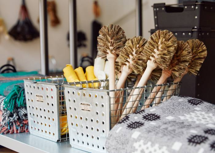 Candles, from £2 each, woodenloo brushes, £6 each, and welsh tapestry blanket, £260