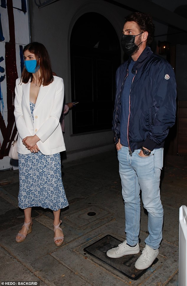 Safety first: With COVID-19 still a lingering danger, the actress wore a blue protective mask while in the close vicinity of people out on the street and in the restaurant