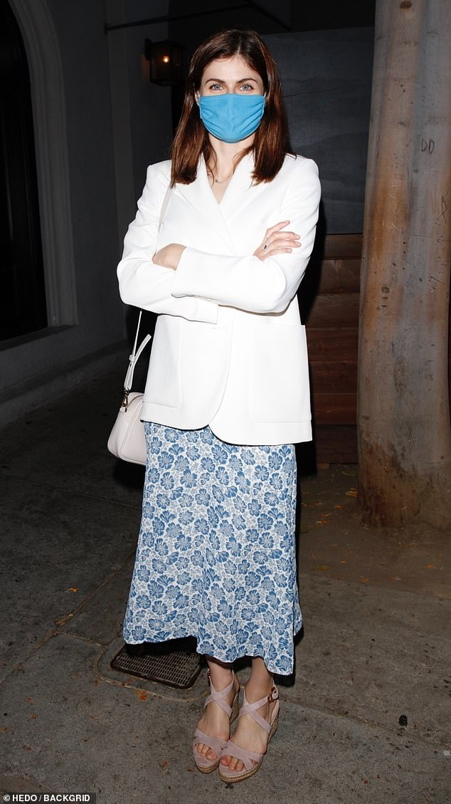 Soft fashion touch: The actress looked summer-ready in a blue and white floral dress, that fell to about mid-calf, and a white blazer