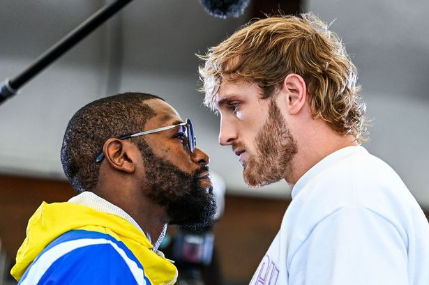 Former world welterweight king Floyd Mayweather (L) and YouTube personality Logan Paul face-off during the media availability ahead of their June 6 exhibition boxing match, on June 3, 2021 at Villa Casa Casuarina at the former Versace Mansion in Miami Beach, on June 3, 2021. (Photo by CHANDAN KHANNA / AFP) (Photo by CHANDAN KHANNA/AFP via Getty Images)