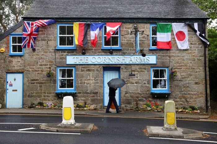 A pub in Cornwall hangs out the flags of the G7 members ahead of the summit this week